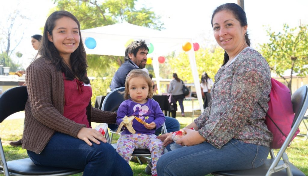 Study participant and her family at the 10-year anniversary event